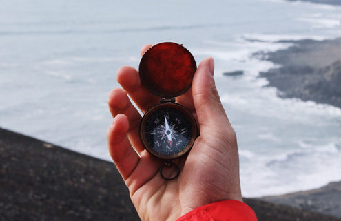 Living Strategically -- Hand Holding Compass